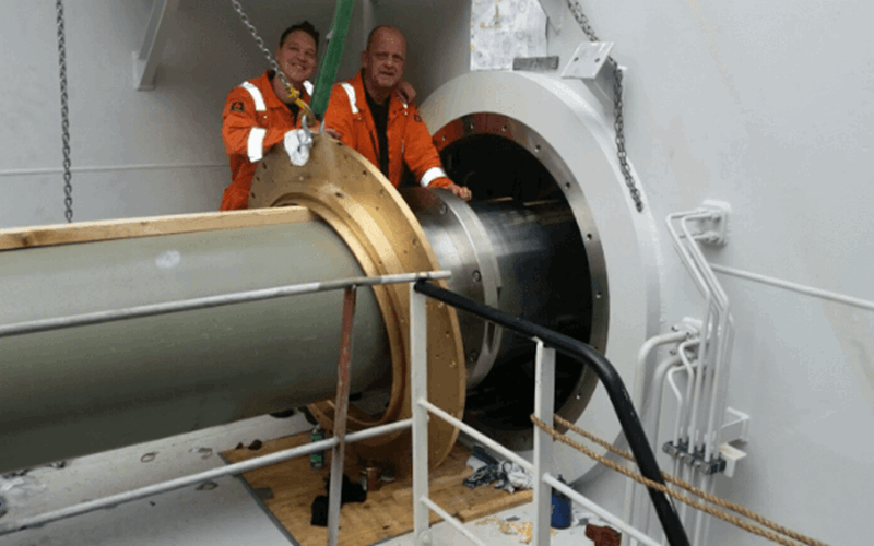 Service engineers installing big size seal